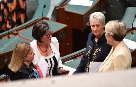 Centre Alliance member for Mayo Rebekha Sharkie (L), Independent Member for Indi Cathy McGowan (2-L), Independent Member for Wentworth Kerryn Phelps (2-R) and Deputy Leader of the Opposition Tanya Plibersek (R) converse after a debate on the National Anti-Corruption Commission in the House of Representatives at Parliament House in Canberra, Australia, 26 November 2018.