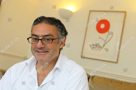 Rabih Hage with a work by Aki Kuroda (red) behind him