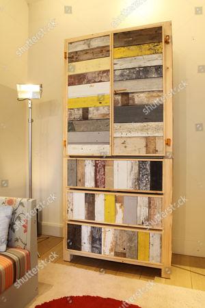 'The Classic Cupboard in Scrap Wood' by Piat Hein Eek  at the showroom of Rabih Hage in Sloane Avenue, Chelsea