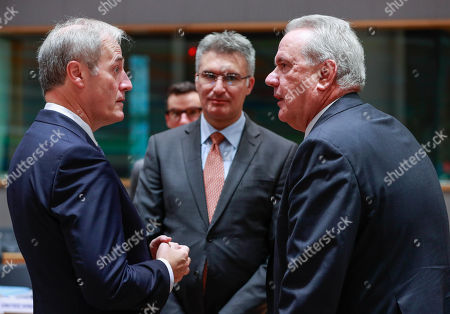 Lord Michael Bates (L), British Minister of State at the Department for International Development, Foreign Minister of Malta Carmelo Abela (C) and Commissioner for International Cooperation and Development of the European Union Neven Mimica at the start of an EU Foreign Affairs Council (FAC) meeting on Development at the European Council in Brussels, Belgium, 26 November 2018. Development ministers will exchange views on the ongoing work on the Africa - Europe alliance for sustainable investment and jobs.