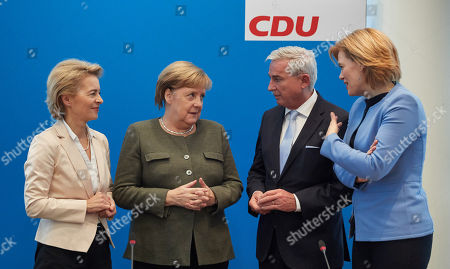 (L-R) Germany's Minister of Defence Ursula von der Leyen, German Chancellor Angela Merkel, Deputy Leader of the Christian Democratic Union (CDU) Thomas Strobl and Minister of Food and Agriculture Julia Kloeckner talk prior to a CDU Federal Executive Board Meeting at the CDU party headquarters in Berlin, Germany, 26 November 2018.