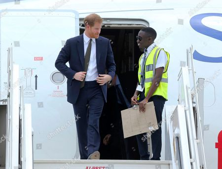 Stock Image of Britain's Prince Harry walks out of a plane upon his arrival at Kenneth Kaunda airport in Lusaka, . Prince Harry is on a State visit to Zambia at the request of the Commonwealth office and is expected to attend various events in the Southern African country