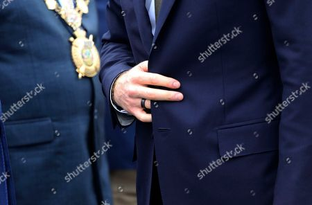 Stock Photo of Britain's Prince Harry adjusts his jacket as he is welcomed upon his arrival at Kenneth Kaunda airport in Lusaka, Zambia, . Prince Harry is on a State visit to Zambia at the request of the Commonwealth office and is expected to attend various events in the Southern African country