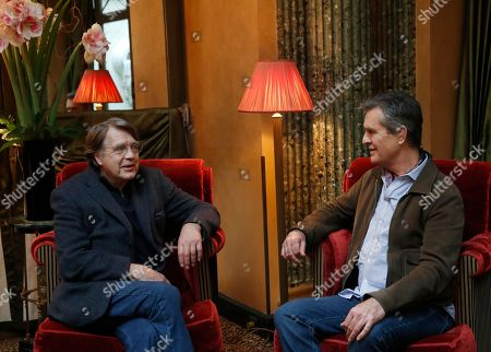 """Director Rupert Everett, right, and Merlin Holland, grandson of Oscar Wilde, pose during a photocall for the film """"The Happy Prince"""" in Paris"""