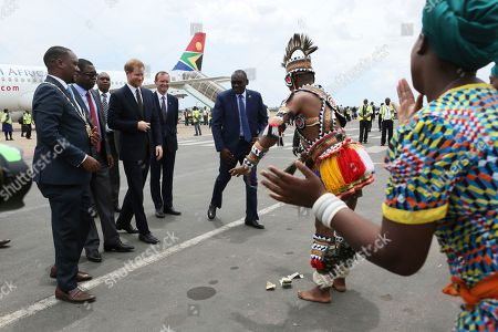 Zambian traditional dancers perform for Britain's Prince Harry, centre left, upon his arrival at Kenneth Kaunda airport in Lusaka, . Prince Harry is on a State visit to Zambia at the request of the Commonwealth office and is expected to attend various events in the Southern African country