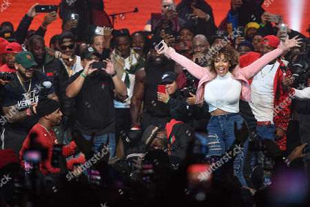 Stock Photo of Juelz Santana (L) proposes to Kimberly Vanderhee onstage