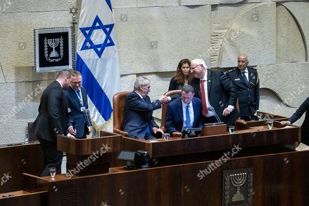 President of the Czech Republic Milos Zeman (L seated) shakes hands with Israeli President Reuven Rivlin (C-R) as Israeli Speaker of the Knesset Yuli Edelstein (C) leans forwards out of their way on the podium after President Zeman addressed a special session of the Israeli Knesset (Parliament) in Jerusalem, 26 November 2018. Zeman is on a two-day official visit to Israel and said he intends to move the Czech Embassy to Jerusalem.