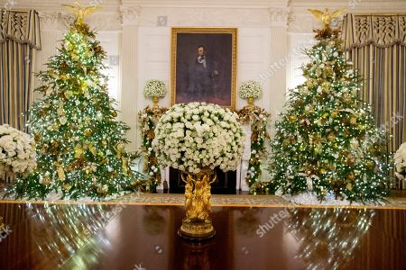 The State Dining Room featuring late US artist George Peter Alexander Healy's portrait of Abraham Lincoln during a viewing of the 2018 holiday decorations at the White House in Washington, DC, USA, 26 November 2018. The theme of the 2018 decorations is 'American Treasures' and is intended to honor the heritage of the United States. Dozens of trees and over fourteen thousand ornaments decorate the White House for the holiday season. Over thirty thousand visitors are expected to participate in public tours throughout the month of December.