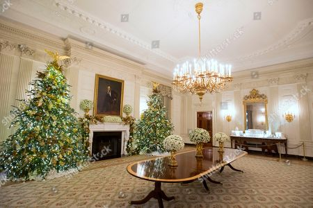 The State Dining Room features late US artist George Peter Alexander Healy's portrait of Abraham Lincoln during a viewing of the 2018 holiday decorations at the White House in Washington, DC, USA, 26 November 2018. The theme of the 2018 decorations is 'American Treasures' and is intended to honor the heritage of the United States. Dozens of trees and over fourteen thousand ornaments decorate the White House for the holiday season. Over thirty thousand visitors are expected to participate in public tours throughout the month of December.