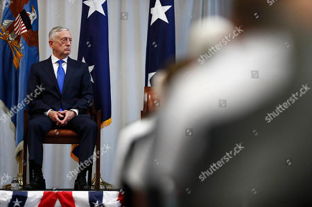 Stock Picture of U.S. Secretary of Defense James Mattis, sits on stage during a change of command ceremony at the n U.S. Southern Command headquarters, in Doral, Fla