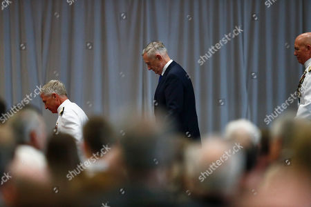 Stock Image of U.S. Secretary of Defense James Mattis, walks off stage during a change of command ceremony at the n U.S. Southern Command headquarters, in Doral, Fla