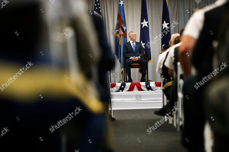 U.S. Secretary of Defense James Mattis, sits on stage during a change of command ceremony at the n U.S. Southern Command headquarters, in Doral, Fla