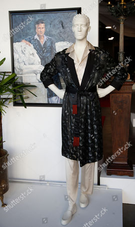 Hugh Hefner silk pajamas and a portrait of him leaning against a statue are displayed as part of the Julien's auction of famed Playboy magazine creator Hugh Hefner's belongings in Beverly Hills, California, USA, 26 November 2018. Hugh Hefner died at the age of 91 on 27 September 2017. The auction of Hefner's personal belongings will take place 30 November and 01 December 2018.