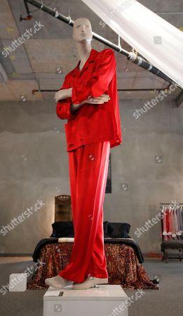 Hugh Hefner's bespoke red silk pajamas are displayed as part of the Julien's auction of famed Playboy magazine creator Hugh Hefner's belongings in Beverly Hills, California, USA, 26 November 2018. Hugh Hefner died at the age of 91 on 27 September 2017. The auction of Hefner's personal belongings will take place 30 November and 01 December 2018.