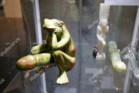 Hugh Hefner's phallic frog and other figures are displayed as part of the Julien's auction of famed Playboy magazine creator Hugh Hefner's belongings in Beverly Hills, California, USA, 26 November 2018. Hugh Hefner died at the age of 91 on 27 September 2017. The auction of Hefner's personal belongings will take place 30 November and 01 December 2018.