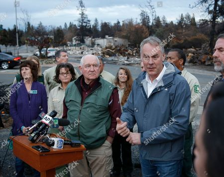 Ryan Zinkew, Sonny Oerdue. Interior Secretary Ryan Zinke, right, answers a reporters question after touring fire ravaged Paradise, Calif. with Agriculture Secretary Sonny Perdue, center, . The pair advocated more aggressive forest management policies to mitigate damage from future wildfires