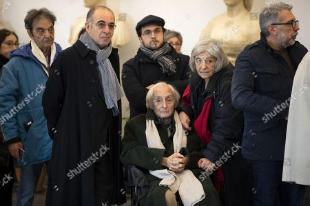 Giuseppe Tornatore (C-L) and Citto Maselli (C, in wheelchair) pay their respects to the late Italian film director Bernardo Bertolucci as his coffin lies in repose at the City Hall in Rome, Italy, 27 November 2018. Bertolucci has died in Rome on 26 November, after suffering from cancer. He was 77.