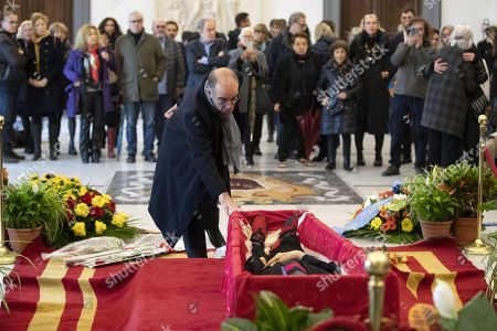 Giuseppe Tornatore pays his respect to the late Italian film director Bernardo Bertolucci as his coffin lies in repose at the City Hall in Rome, Italy, 27 November 2018. Bertolucci has died in Rome on 26 November, after suffering from cancer. He was 77.