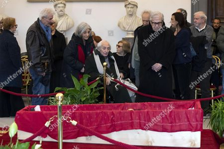 Italian directors Citto Maselli (C, in wheelchair) and Paolo Taviani (C-R) pay their respects to the late Italian film director Bernardo Bertolucci as his coffin lies in repose at the City Hall in Rome, Italy, 27 November 2018. Bertolucci has died in Rome on 26 November, after suffering from cancer. He was 77.