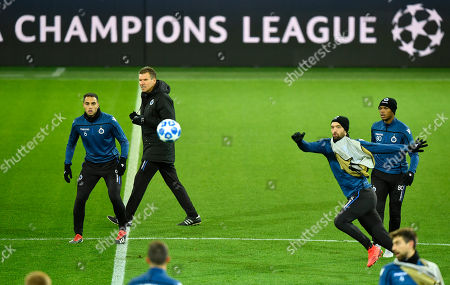 Brugge's Benoit Poulain, right, and Brugge's Sofyan Amrabat, left, look for the ball during a training session in the Dortmund stadium prior the Champions League group A soccer match between Borussia Dortmund and Club Brugge in Dortmund, Germany
