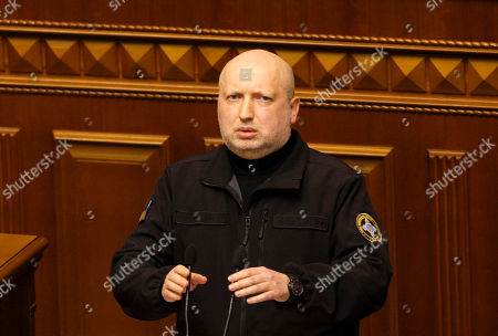 Stock Photo of Ukrainian National Security Council Secretary Oleksandr Turchynov speaks before a vote to introduce martial law, after Russia seized Ukrainian naval ships off the coast of Russia-annexed Crimea, during an Ukrainian Parliament session in Kiev.
