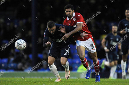 Michael Kightly of Southend United and Zeki Fryers of Barnsley in action during the FA Cup Second Round match between Southend United and Barnsley at Roots Hall in Southend, UK - 1st December 2018