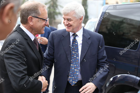 UK Ambassador in Jordan Edward Oakden (R) shakes hands with the Director of UNRWA operation in Jordan Roger Davies, on his arrival for a joint press conference at Whedat Refugee camp in the North East of Amman, Jordan, 27 November 2018. United Nations Relief and Works Agency (UNRWA) for Palestine Refugees and the Government of United Kingdom launched a multi-Year Agreement to support UNRWA Syria regional crisis emergency appeal for a total amount of 6.4 million US dollars over the period between 2018-2021.