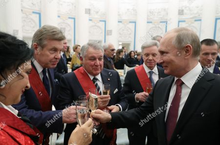 (R-L) Russian President Vladimir Putin, the 'Military Brotherhood' Russian veteran public organizaion Chairman Boris Gromov, the National Research Centre 'Kurchatov Institute' President Mikhail Kovalchuk, Russian singer Lev Leshchenko and Russia's national rhythmic gymnastics team Chief Coach Irina Viner-Usmanova toast after a state awards ceremony  at the St. Catherine Hall in the Kremlin in Moscow, Russia, 27 November 2018.
