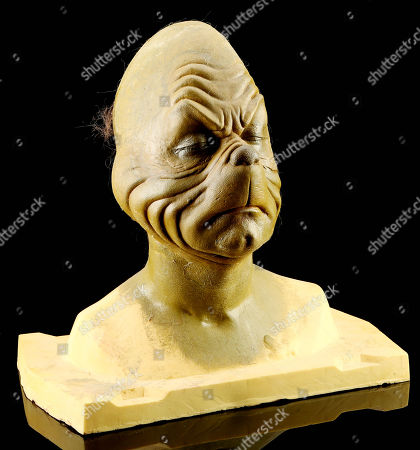 A Grinch make-up test from Ron Howard's How the Grinch Stole Christmas. This pre-production bust was created during early tests, and features a sculpt by legendary make-up artist Rick Baker, designed for himself as the character