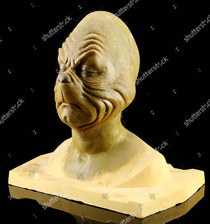 Stock Image of A Grinch make-up test from Ron Howard's How the Grinch Stole Christmas. This pre-production bust was created during early tests, and features a sculpt by legendary make-up artist Rick Baker, designed for himself as the character