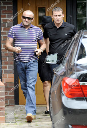 Mark Croft and a friend obscure Kerry Katona as she leaves the house to travel to her birthday party