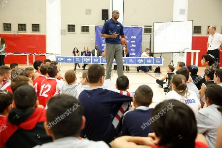 NBA Hall of Famer Dikembe Mutombo talks to kids during a workshop at the Sylvan Adams sports center at the YMCA In Jerusalem