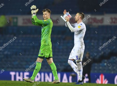 Bailey Peacock-Farrell of Leeds United and man of the match Barry Douglas of Leeds United celebrate at full time