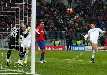 Plzen Lukas Hejda, right, shoots past CSKA goalkeeper Igor Akinfeev to score his team's second goal during the Group G Champions League soccer match between CSKA Moscow and Viktoria Plzen at the Luzhniki Stadium in Moscow, Russia