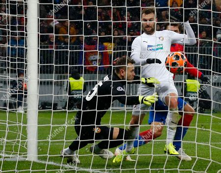 CSKA goalkeeper Igor Akinfeev dives ahead of Plzen Radim Reznik but cannot save the goal from Plzen Lukas Hejda during the Group G Champions League soccer match between CSKA Moscow and Viktoria Plzen at the Luzhniki Stadium in Moscow, Russia
