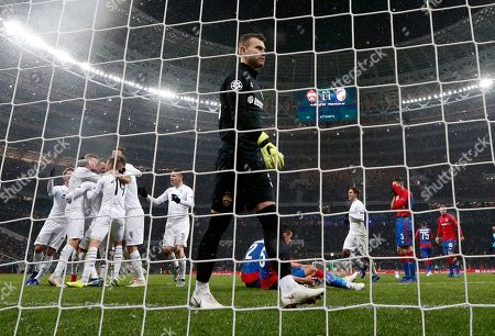 CSKA goalkeeper Igor Akinfeev reacts as Plzen players celebrate after Plzen Lukas Hejda scored his side's second goal during the Group G Champions League soccer match between CSKA Moscow and Viktoria Plzen at the Luzhniki Stadium in Moscow, Russia