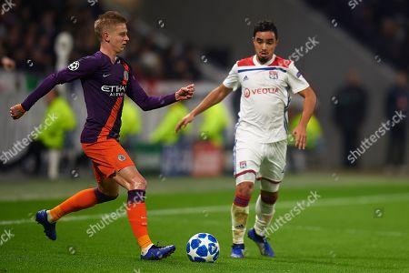Oleksandr Zinchenko of Manchester City and Rafael Da Silva of Olympique Lyon
