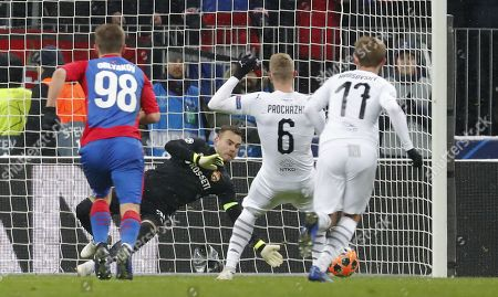 Goalkeeper of CSKA Moscow Igor Akinfeev (2-L) in action during the UEFA Champions League Group G soccer match between CSKA Moscow and FC Viktoria Plzen at Luzhniki Stadium in Moscow, Russia, 27 November 2018.