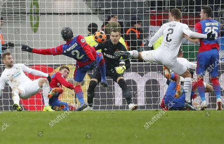 Goalkeeper Igor Akinfeev (C) and Mario Fernandes (3-L) of CSKA Moscow in action against Lukas Hejda (2-R) of FC Viktoria Plzen during the UEFA Champions League Group G soccer match between CSKA Moscow and FC Viktoria Plzen at Luzhniki Stadium in Moscow, Russia, 27 November 2018.