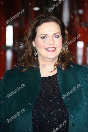 Philippa Boyens poses for photographers upon arrival at the premiere of the film 'Mortal Engines' in central London