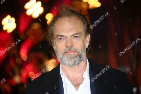 Hugo Weaving poses for photographers upon arrival at the premiere of the film 'Mortal Engines' in central London