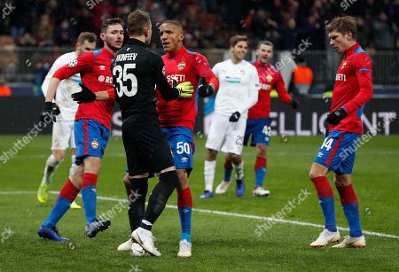 CSKA Moscow players cheers CSKA goalkeeper Igor Akinfeev after he saved a penalty shot during the Group G Champions League soccer match between CSKA Moscow and Viktoria Plzen at the Luzhniki Stadium in Moscow, Russia