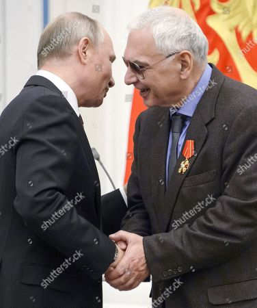 Russian President Vladimir Putin (left) and film director, general director of Mosfilm film concern Karen Shakhnazarov (right) during the ceremony