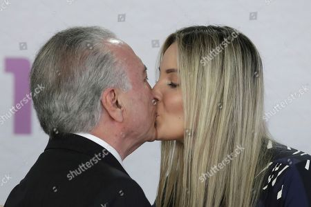 Michel Temer, Marcela Temer. Brail's President Michel Temer kisses his wife Marcela Temer during a ceremony to launch the National Plan to Combat Domestic Violence against Women, at the Planalto Presidential Palace, in Brasilia, Brazil