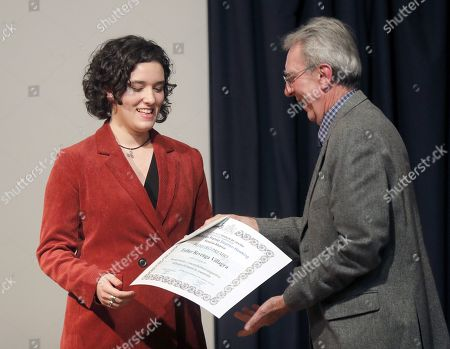 Stock Picture of French chemistry researcher and 2016 Chemistry Nobel laureate Jean-Pierre Sauvage (R) gives the 'Stephen Hawking-Rosalia Abanca' award to student Esther Revenga, at the Rosalia de Castro Institute in Santiago de Compostela, Galicia, northern Spain, 27 November 2018.