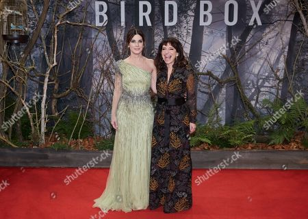 Sandra Bullock (L) and Danish director Susanne Bier (R) pose as they arrive for the premiere of the movie 'Bird Box' at the Zoo Palast venue in Berlin, Germany, 27 November 2018.