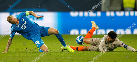 Hoffenheim's Kevin Vogt (L) in action against Donetsk's Taison (R) during the UEFA Champions League Group F round match between TSG 1899 Hoffenheim and FC Shakhtar Donetsk in Sinsheim, Germany, 27 November 2018.