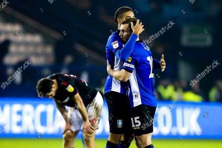 Tom Lees and Michael Hector of Sheffield Wednesday celebrate victory over Bolton Wanderers