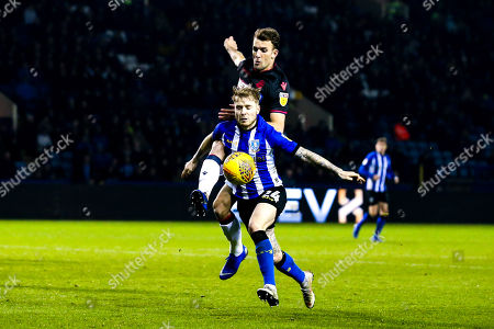 Stock Picture of Christian Doidge of Bolton Wanderers challenges Ashley Baker of Sheffield Wednesday