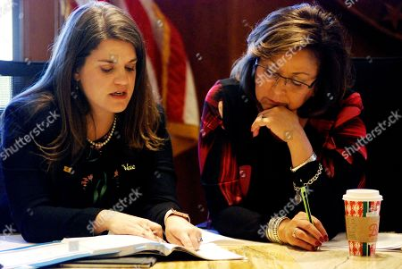 New Mexico Gov. Susana Martinez, right, and Secretary of State Maggie Toulouse Oliver, left, certify election results and order recounts in a handful of state House races in Santa Fe, N.M.,, as members of the State Canvassing Board. New Mexico is certifying election results that give Democrats unfettered control of every statewide office and the state's five-member delegation to Capitol Hill